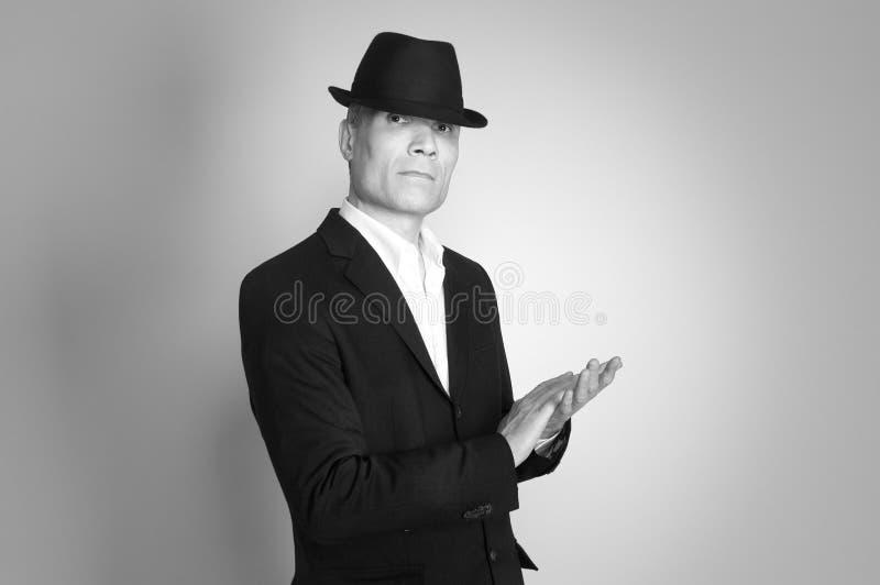 Uomo in vestito e black hat immagini stock libere da diritti