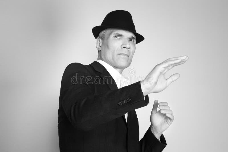 Uomo in vestito e black hat fotografie stock libere da diritti