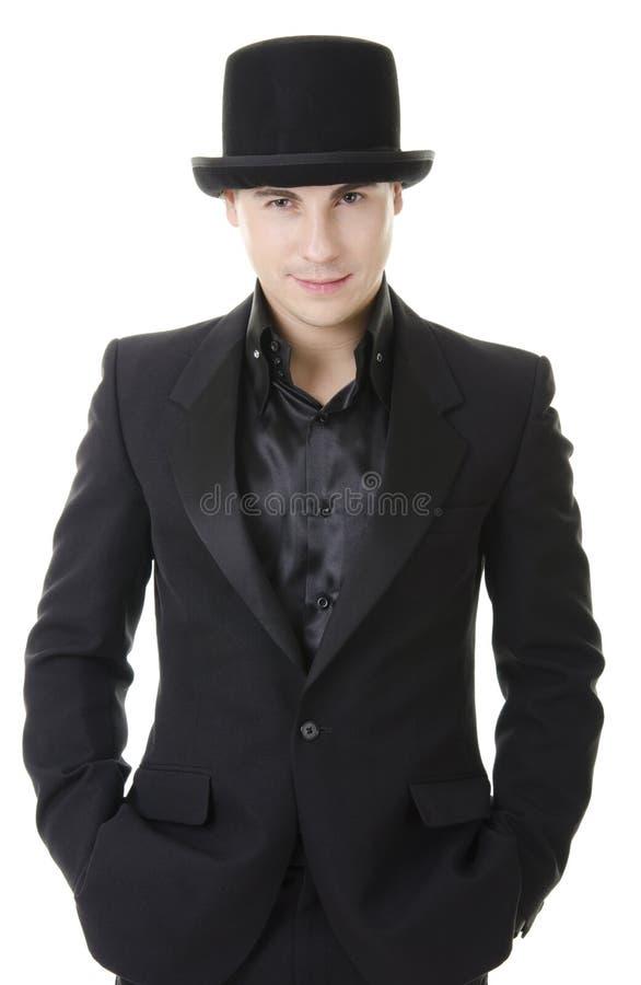 Uomo in vestito e cappello austeri neri immagine stock