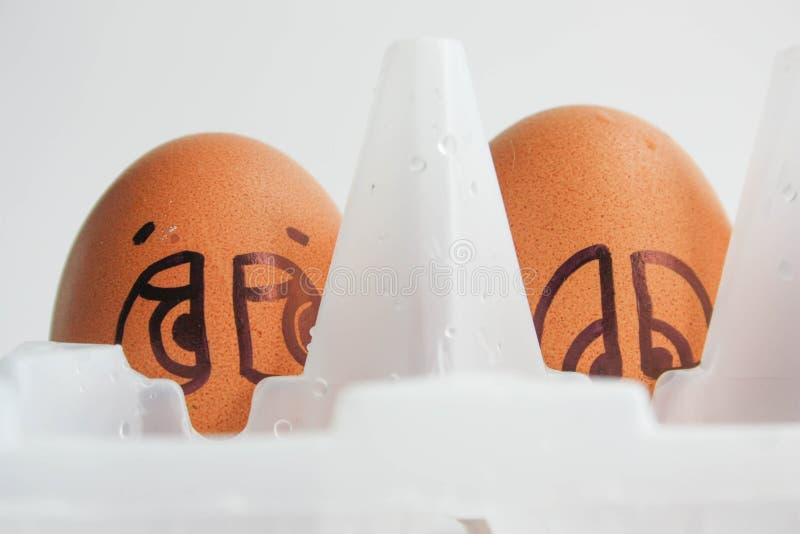 Uova con il fronte dipinto Foto per la vostra progettazione fotografia stock
