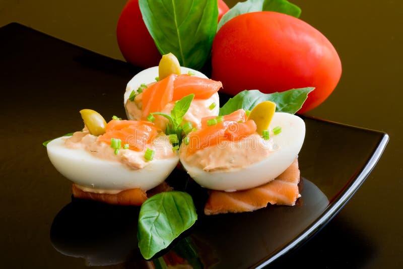 Uova e salmoni fotografie stock libere da diritti