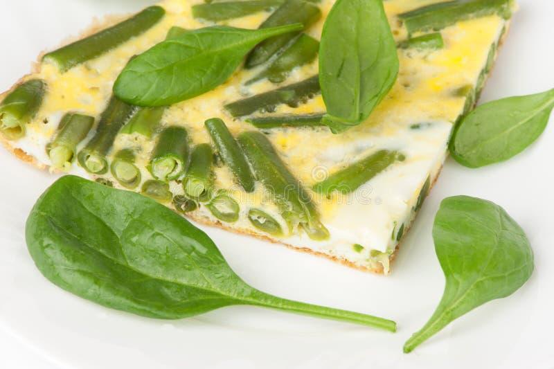 Uova fritte con spinaci fotografia stock libera da diritti