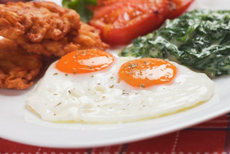 Uova fritte per la prima colazione fotografia stock libera da diritti