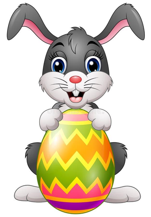 Uovo di Pasqua Della holding del coniglietto del fumetto royalty illustrazione gratis