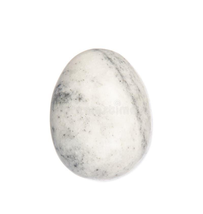 Uovo di pietra dell'onyx su bianco immagine stock