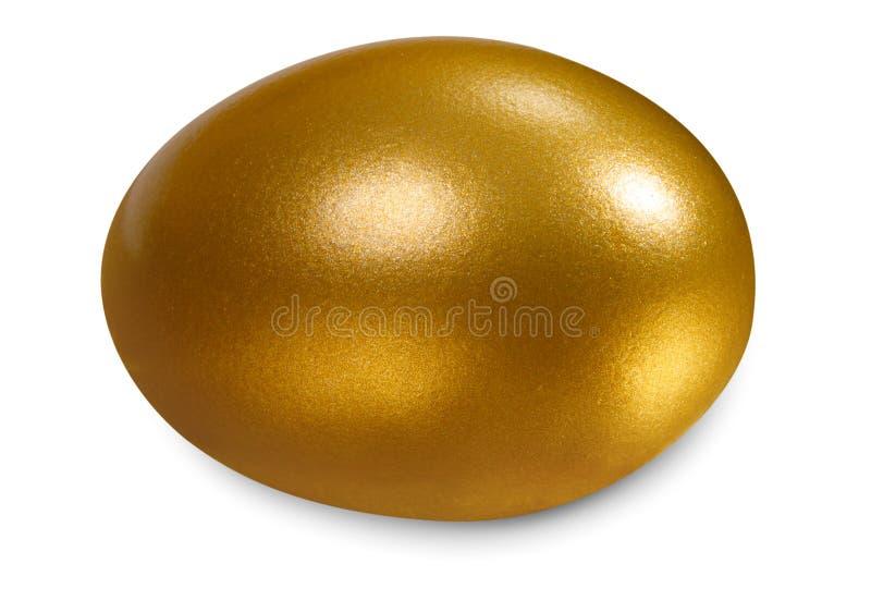 Uovo dorato, concetto di fabbricazione dei soldi immagini stock