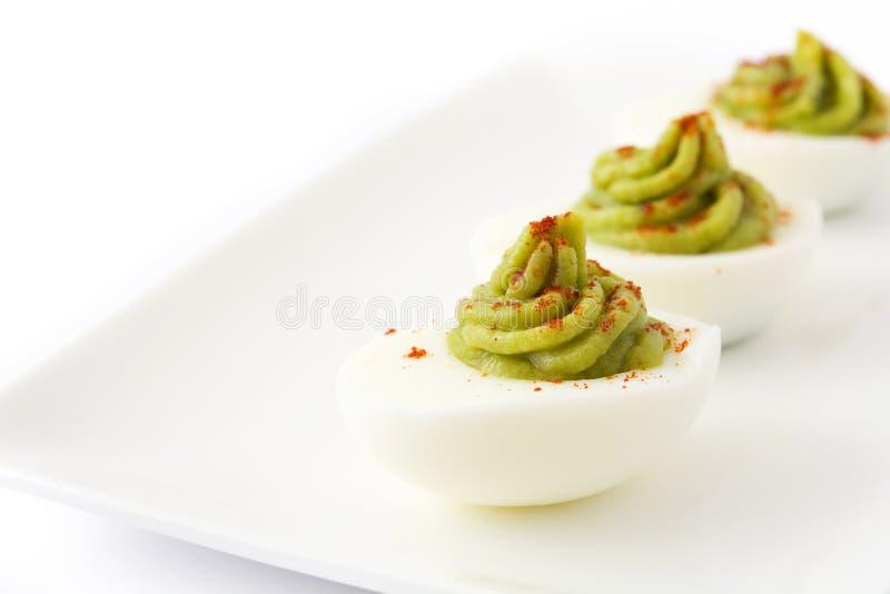 Uovo farcito con guacamole isolato fotografia stock libera da diritti