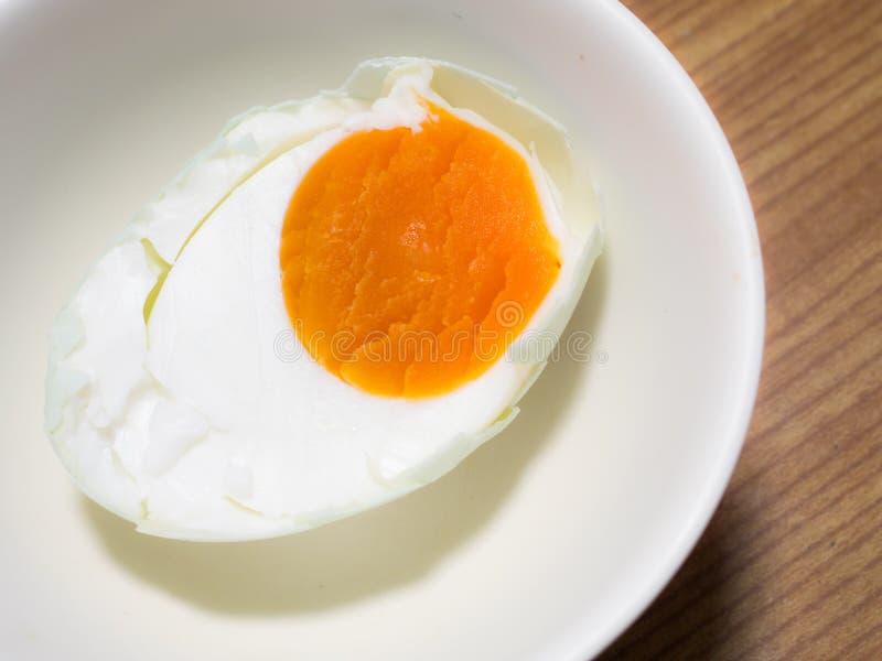 Download Uovo salato sul piatto immagine stock. Immagine di arancione - 56886979