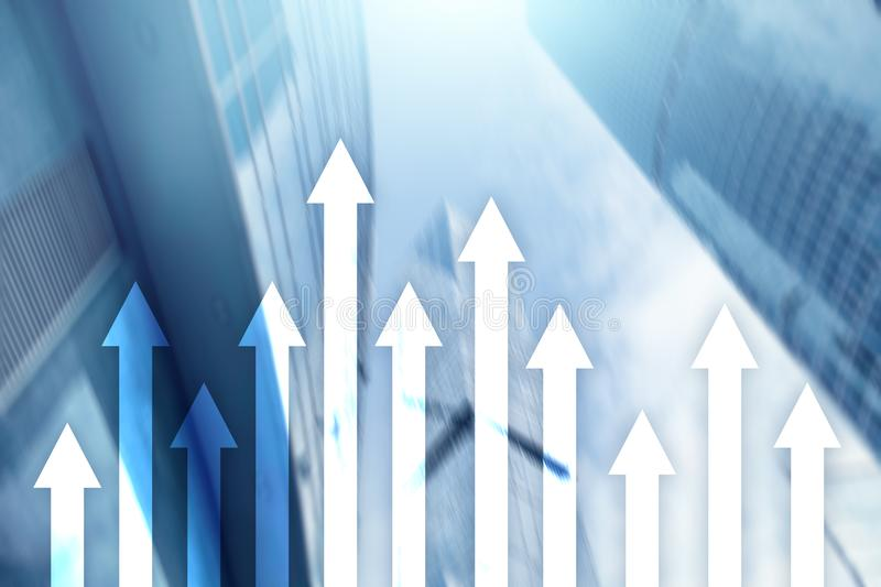 Up arrow graph on skyscraper background. Invesment and financial growth concept stock photos
