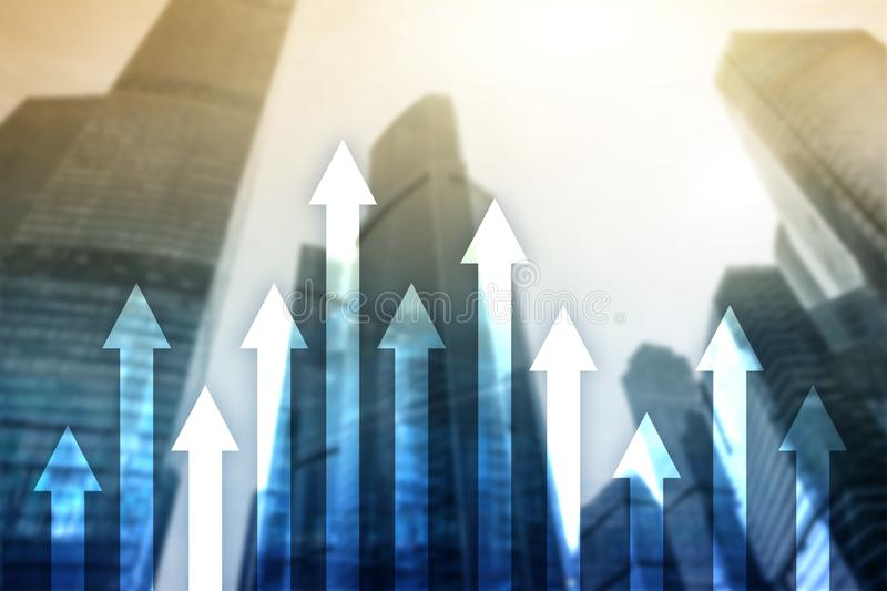 Up arrow graph on skyscraper background. Invesment and financial growth concept.  stock image