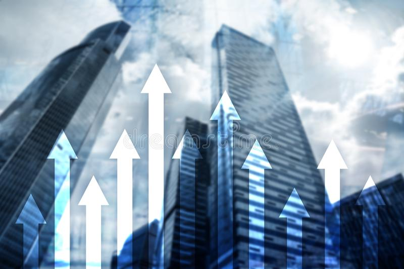 Up arrow graph on skyscraper background. Invesment and financial growth concept.  royalty free stock image