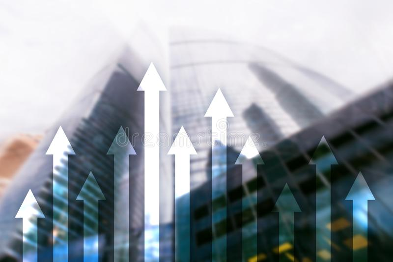 Up arrow graph on skyscraper background. Invesment and financial growth concept.  stock photography