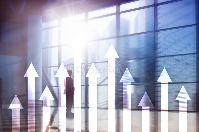 Up arrow graph on skyscraper background. Invesment and financial growth concept.  stock photo
