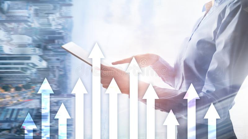 Up arrow graph on skyscraper background. Invesment and financial growth concept. royalty free stock images
