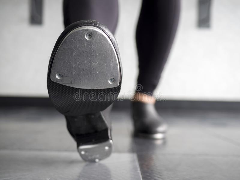 Heel toe in tap shoes in dance class. Up-close of a dancer doing a Heel toe step in tap shoes in dance class stock photo