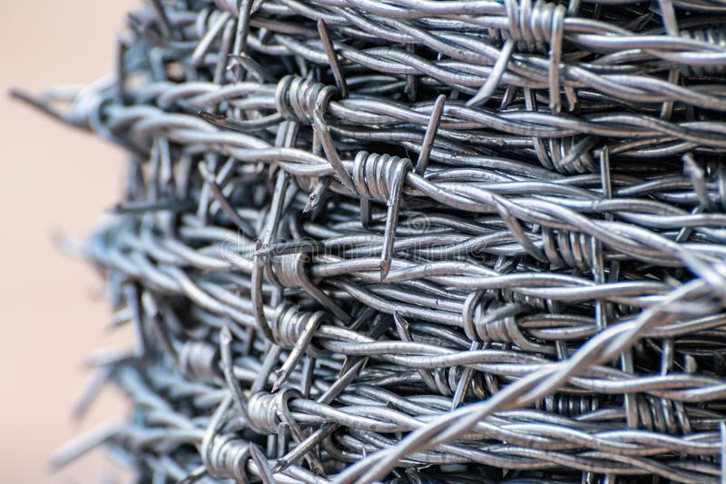 Up close on shiny new barbed wire stock photography