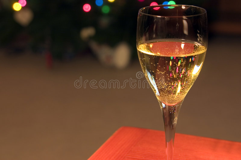 Up Close on a Wine Glass. Close up on a Wine Glass with the Christmas lights on the background stock image