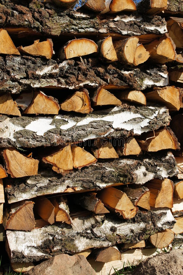 Up-coated wood. Sawn into pieces and piled logs royalty free stock photo