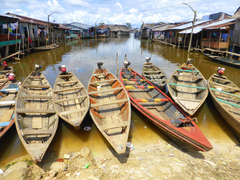 Dugout canoes beached on shore. The floating town in Iquitos, Peru royalty free stock image