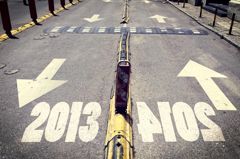 Up and down. Arrow signs on the road with next and passed year stock image