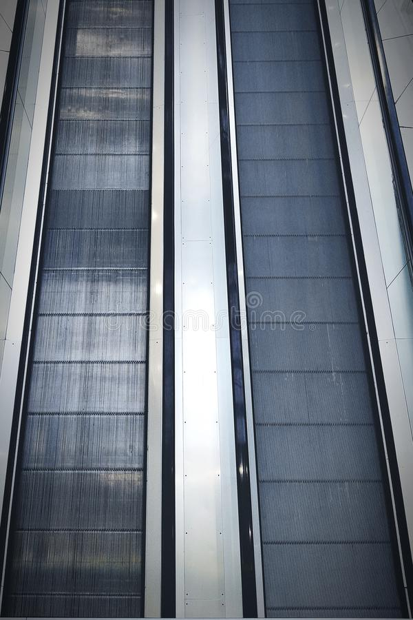 Up and down. Down escalator lines nopeople achievement royalty free stock photos