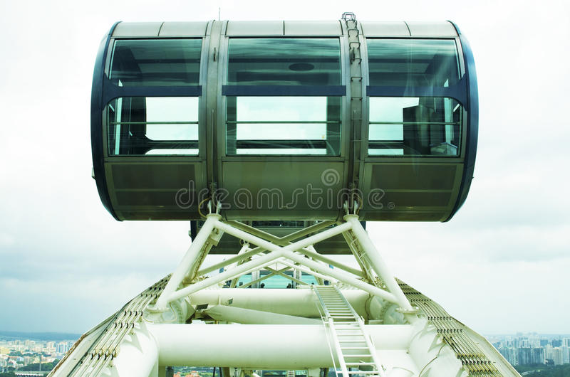 Up in the sky, so high. Capsule of Singapore Flyer over the city skyline stock photos