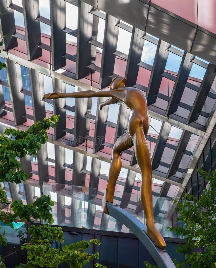 Up There-Sculpture on First Street, Manchester. One of five 2.5m sculptures set on 5m stainless steel columns by Collin royalty free stock photo