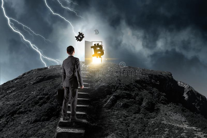 Up to financial success. Mixed media. Businessman climbing stone stairway with crypto currency on top. Mixed media royalty free stock photo