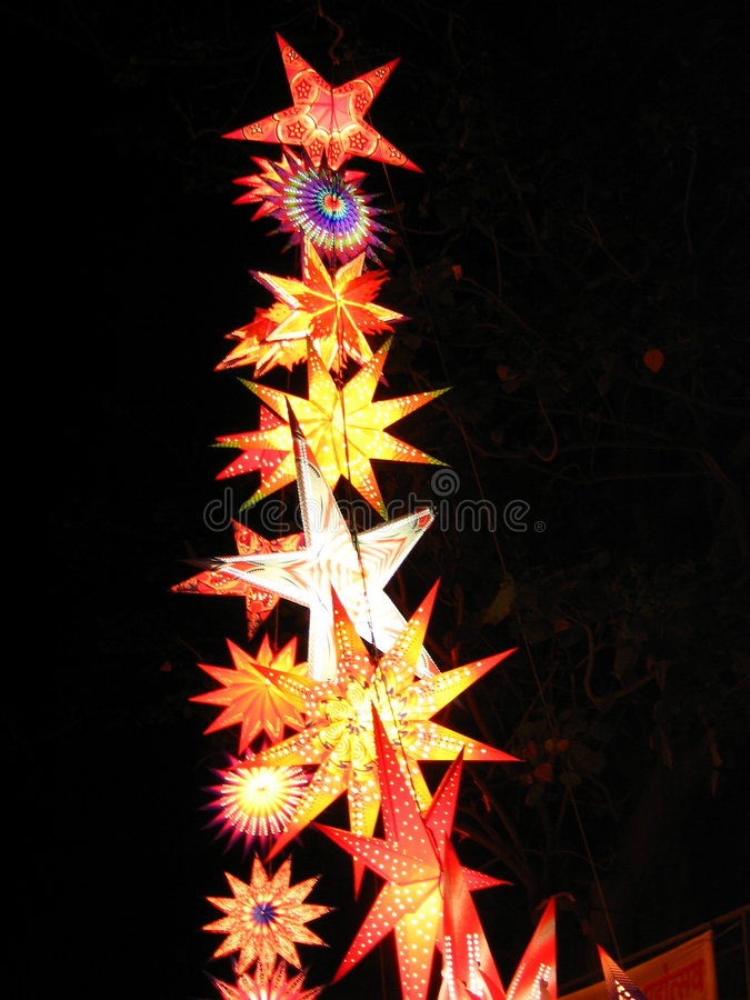 Up Up and Away. Star Shaped Sky laterns are lit high up to the trees on the festive occasion of Diwali / Christmas in India royalty free stock photo
