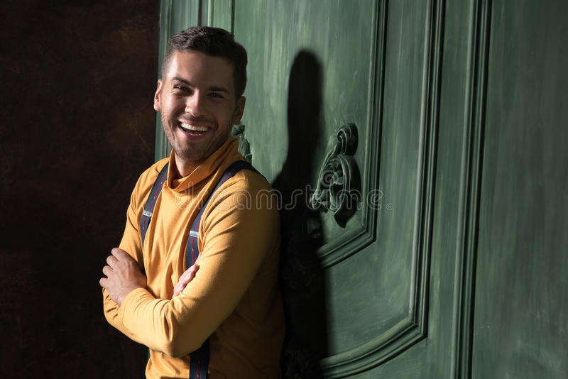 Upbead young guy standing with smile stock photo