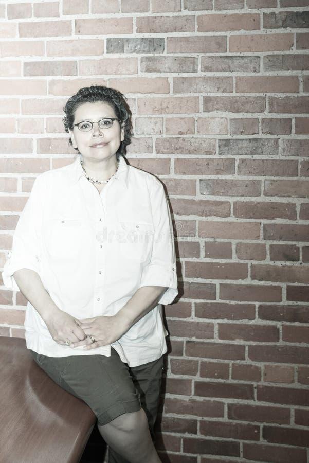 Upbeat Breast Cancer Survivor In Work Environment. Upbeat Female Breast Cancer Survivor In Work Environment stock photo