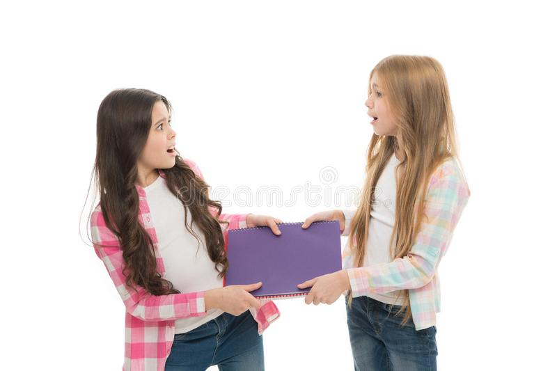 Upbringing and greediness problem. Greedy friends. Greedy children concept. Share book with classmate. This is my stock image