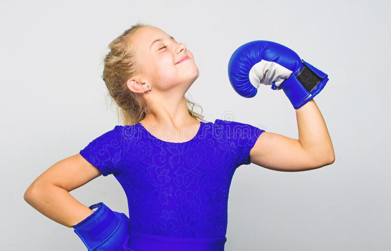 Upbringing for leadership and winner. Feminist movement. Strong child proud winner boxing competition. Girl child happy. Winner with boxing gloves posing on stock images