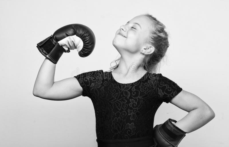 Upbringing for leadership and winner. Feminist movement. Strong child proud winner boxing competition. Girl child happy. Winner with boxing gloves posing on royalty free stock image