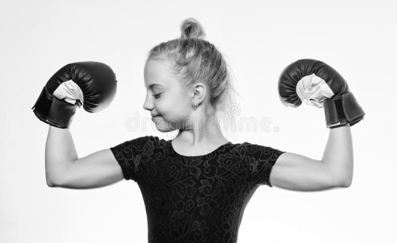 Upbringing for leadership and winner. Strong child boxing. Sport and health concept. Boxing sport for female. Be strong. Girl child with blue gloves posing on royalty free stock photography