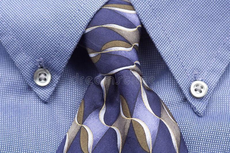 Upclose of blue shirt and tie stock image