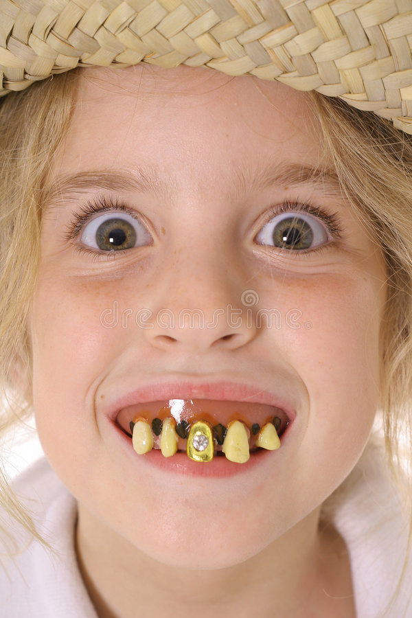 Upclose marcio del bambino dei denti immagini stock