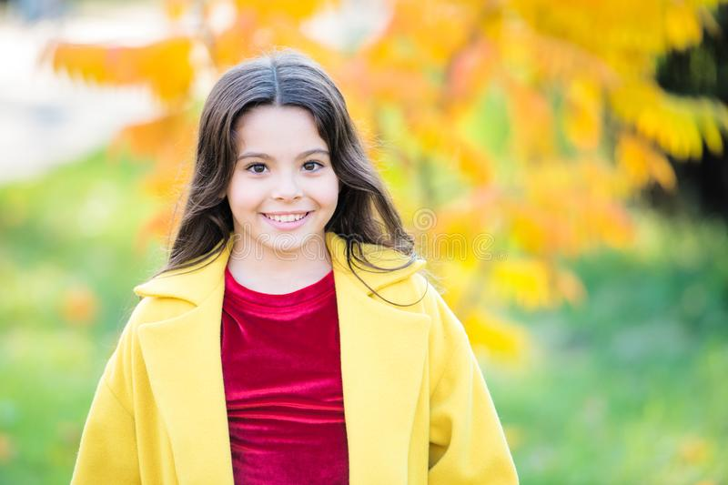 Upcoming events. Autumn beauty. Girl smiling face walking in park. Trendy girl in autumn coat. Weather forecast. Happy. Little child outdoors nature background stock photos