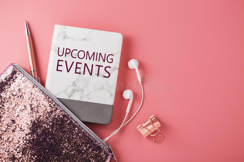 Upcoming events on pink background stock photo