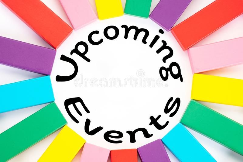 Upcoming Events written on a white paper with a colorful wooden blocks toys to remind you and important appointment royalty free stock photos