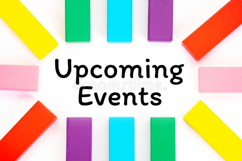 Upcoming Events written on a white paper with a colorful wooden blocks toys to remind you and important appointment royalty free stock photography