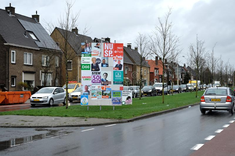 Upcoming provincial and senatorial election at the 20th of March 2019 Netherlands. Road sign with posters of political parties on the circular road around stock photography