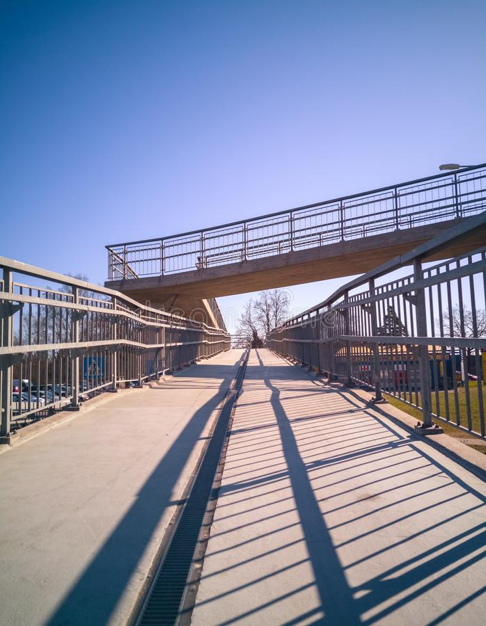Upgoing steel and concrete bridge over the street royalty free stock image