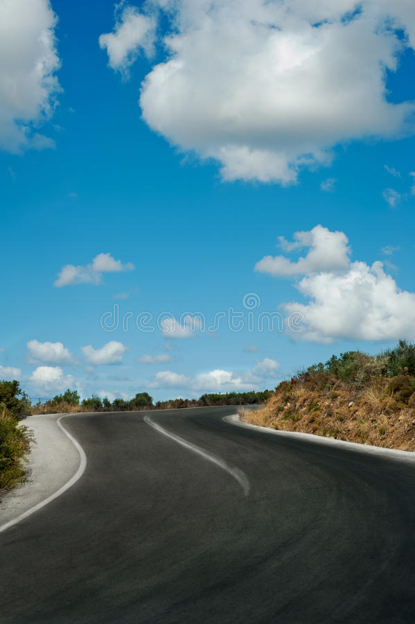 Uphill road in mountains royalty free stock photo