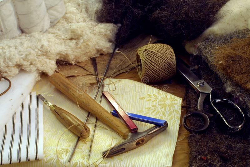 Upholstery. Craftsmans tools and materials for bed upholstery stock photo