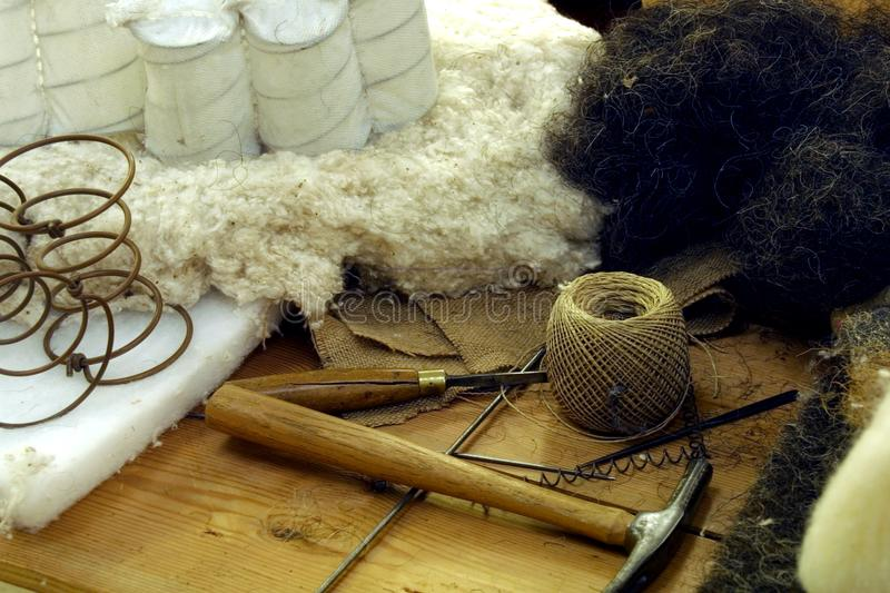 Upholstery. Craftsmans tools and materials for bed upholstery royalty free stock images