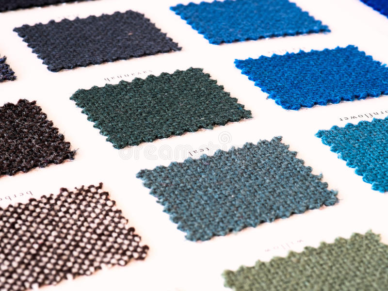 Upholstery fabric samples. In cool blue tones stock photography