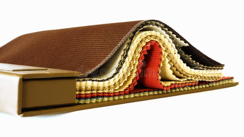 Upholstery fabric samples. In warm & earthy tones royalty free stock photo