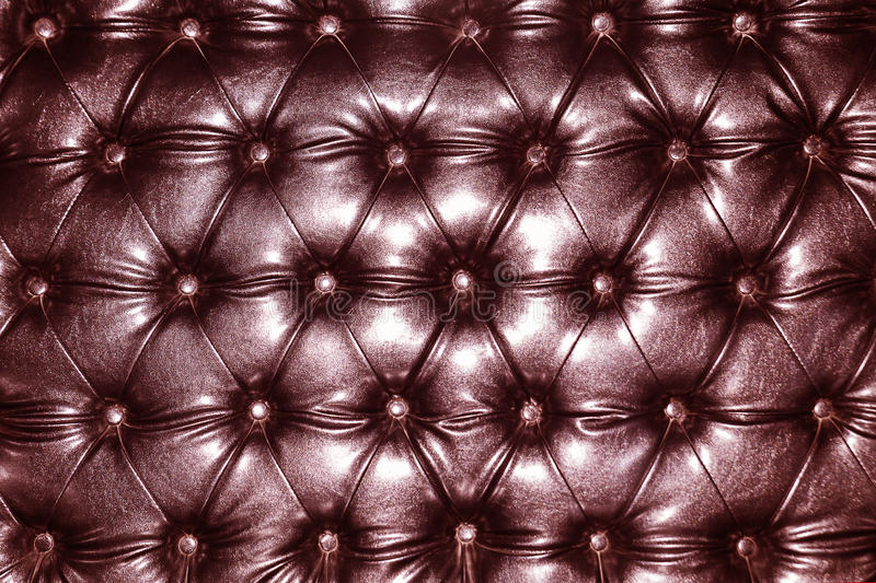 Upholstery. Luxurious marsala color leather texture furniture with buttons, upholstery stock photo