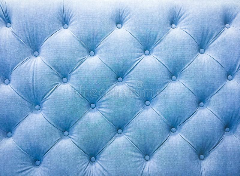 Upholstery sofa fabric with rivets. stock photos